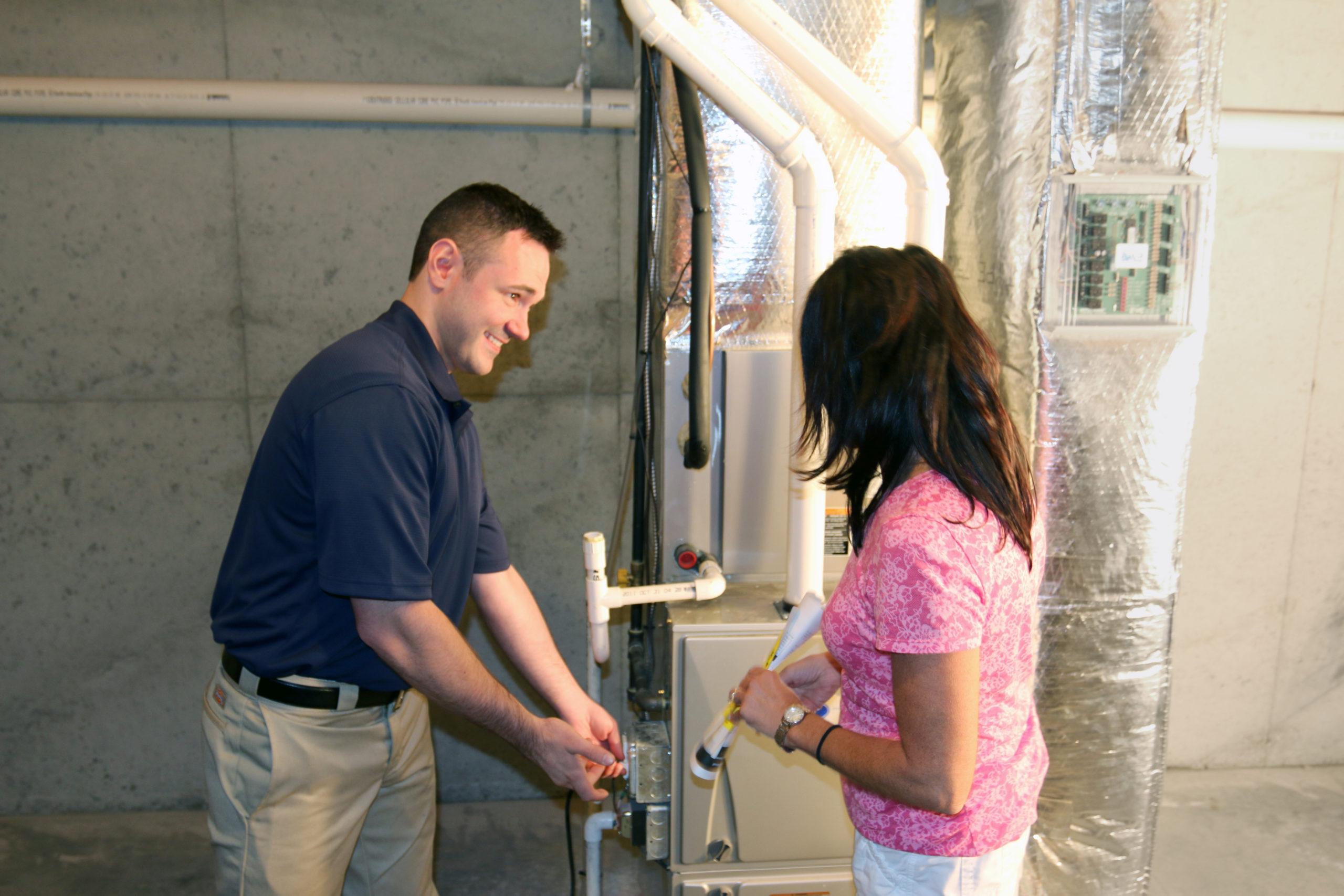 technician performing furnace maintenance